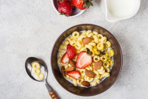 cheerios in a bowl with strawberries