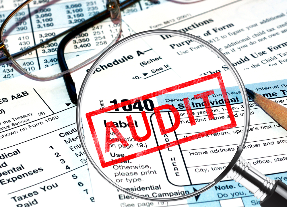 tax forms with an audit stamp