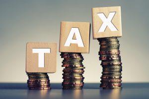 tax blocks on money coins